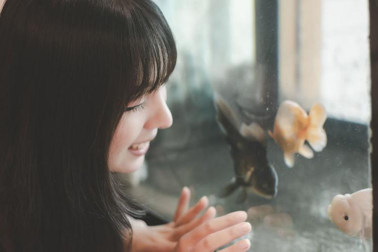 Woman looking at fish tank