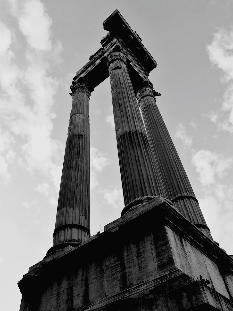 sky, low angle view, architecture, built structure, cloud - sky, nature, history, the past, building exterior, tourism, day, travel destinations, no people, ancient, travel, architectural column, ancient civilization, tall - high, outdoors, memorial, archaeology, ruined