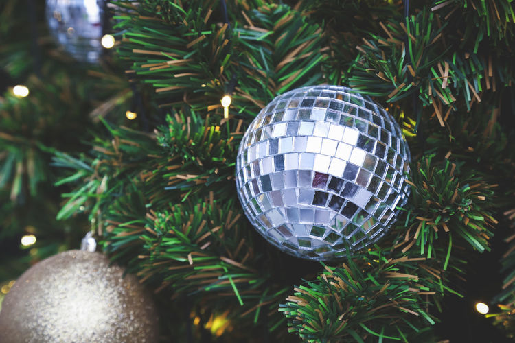 Glass ball decorated on the Christmas tree Bauble Celebration Christmas Christmas Bauble Christmas Decoration Christmas Ornament Christmas Tree Close-up Decoration Disco Ball Green Color Hanging Holiday - Event Illuminated Indoors  Night No People Reflection Shiny Sphere Tradition Tree