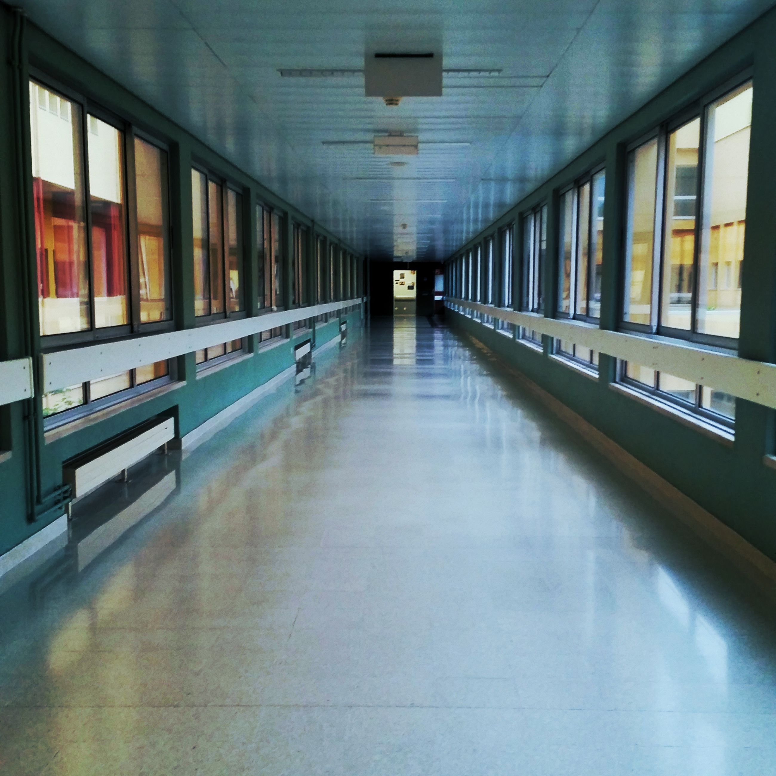 architecture, indoors, no people, empty, diminishing perspective, direction, education, flooring, the way forward, building, arcade, absence, corridor, built structure, illuminated, day, ceiling, reflection, in a row, long