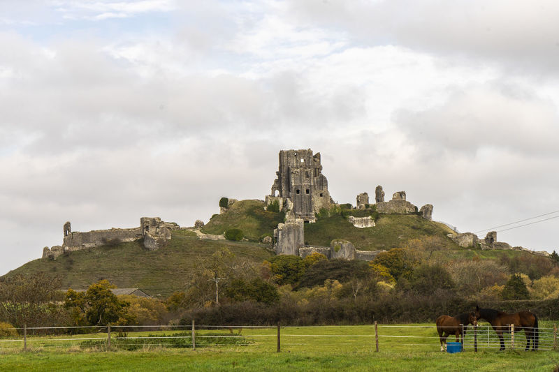 The castle at Corfe Castle, viewed from the west Architecture Building Exterior History Built Structure The Past No People Castle Ancient Ruined Outdoors Building Corfe Castle Day Old Ruined Castle English Civil War