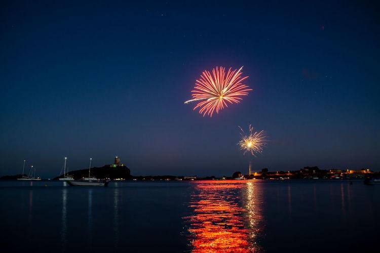 Firework display over nora bay, sardinia