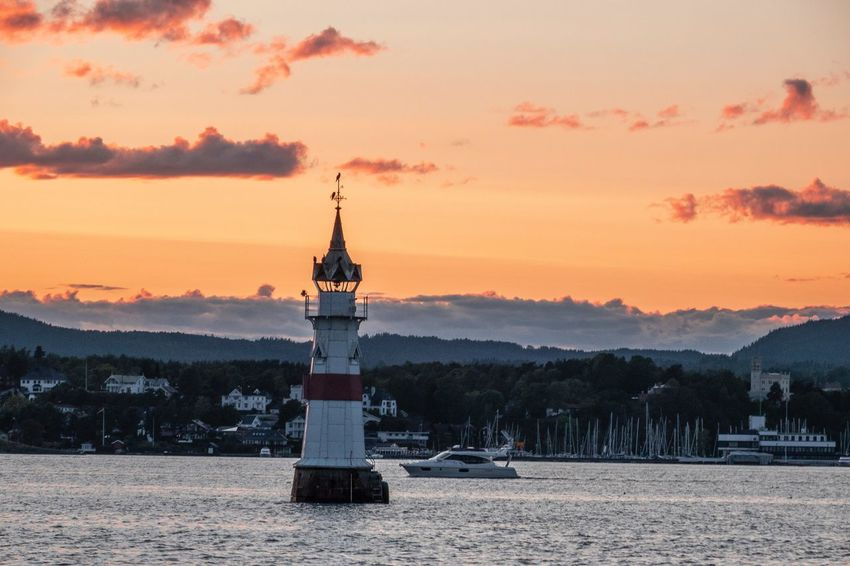 Kavringen Lighthouse #rx100vi #sony #oslofjord #sunset #norway #fjord #oslofjord Sunset Sky Built Structure Architecture Building Exterior Orange Color Tower Waterfront