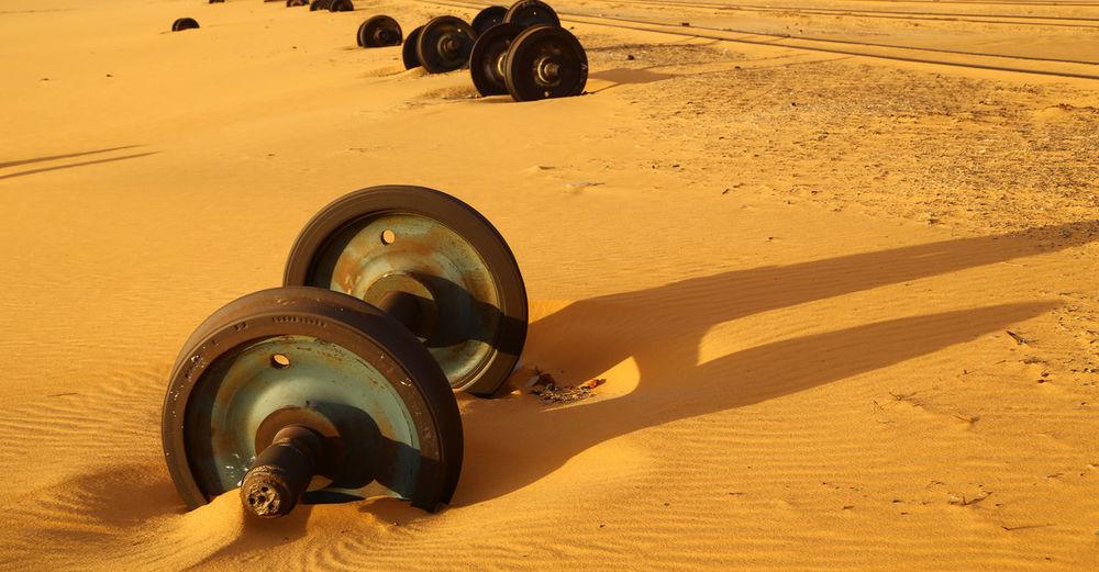 Close-up of vintage car on sand