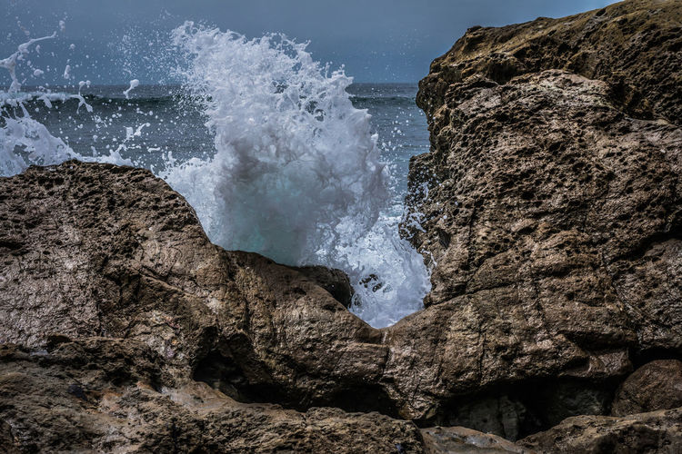 Waves Breaking On Rocks