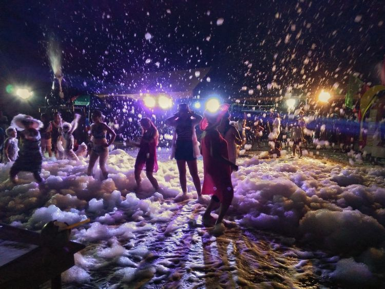 Live For The Story Eyeem Market EyeemPhilippines Night Foamparty Coldsummernight Large Group Of People Fun Illuminated Enjoyment Crowd Lifestyles Celebration Arts Culture And Entertainment Nightlife Men Cold Temperature Nature People Winter Real People Women Adult Outdoors Audience