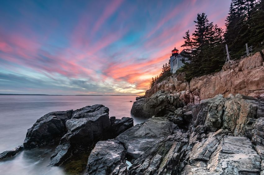 Bass harbor lighthouse at sunset in Acadia National park Sunset Acadia Acadia National Park Maine Lighthouse Bass Harbor Lighthouse Sky Sea Water Beauty In Nature Sunset Scenics - Nature Rock Beach Tranquility Rock - Object Cloud - Sky Tranquil Scene Nature Land Solid Horizon Idyllic Horizon Over Water No People EyeEmNewHere