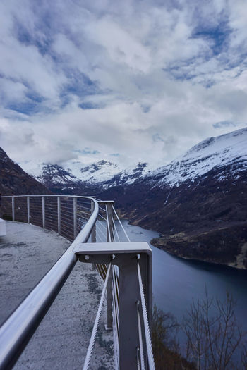 Architecture Bridge - Man Made Structure Clouds Connection Day Detail Fence Geiranger Geirangerfjord Mountain Nature Nature Nature Photography Naturelovers Naturephoto No People Norway Outdoors Scenics Sky Snow Suspension Bridge Tourism Travel Destinations Water