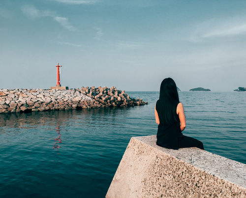 AMPt_community Beauty In Nature Cloud - Sky Day Full Length Groyne Horizon Over Water Lighthouse Nature One Person Outdoors People Real People Rear View Relaxing Retaining Wall Rock - Object Scenics Sea Seascape Serenity Sky Standing Water Women