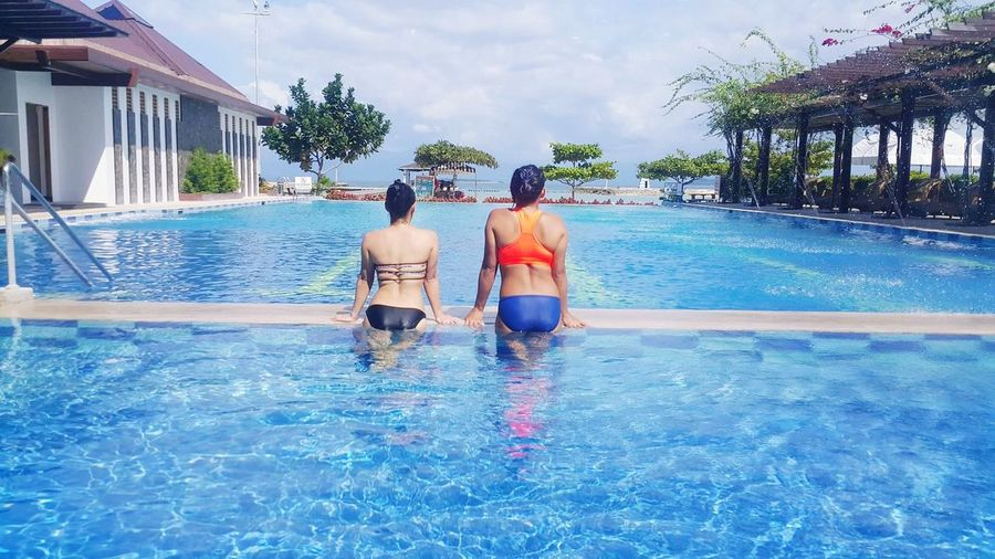 Rear view of women in swimming pool