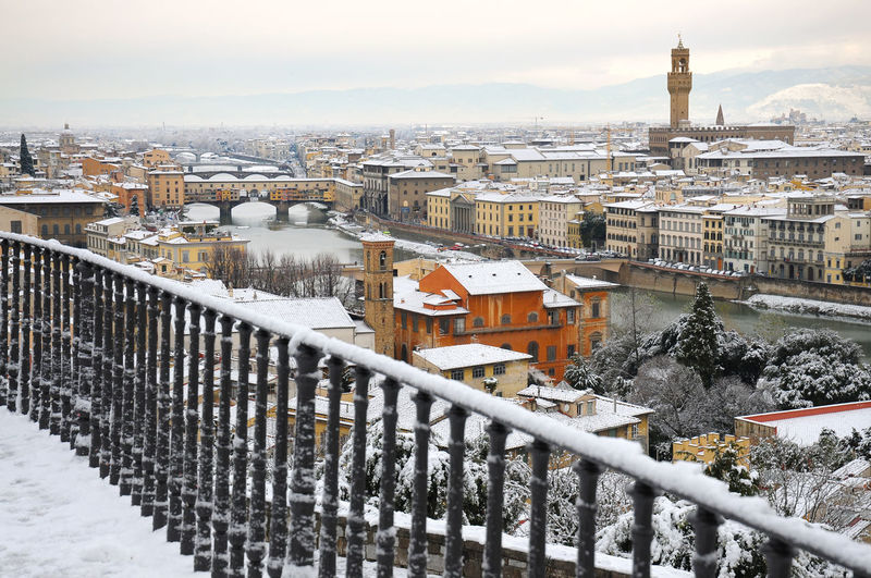 Beautiful Cityscape of Florence and the famous Old Bridge in winter. As seen from Piazzale Michelangelo, Italy. Christmas Cityscape Firenze Florence Italy Panorama Piazzale Michelangelo Ponte Vecchio - Firenze Toscana Tuscany View Xmas Architecture Bridge Cold Temperature Giotto Old Outdoors Snow Snowfall Urban Skyline Winter