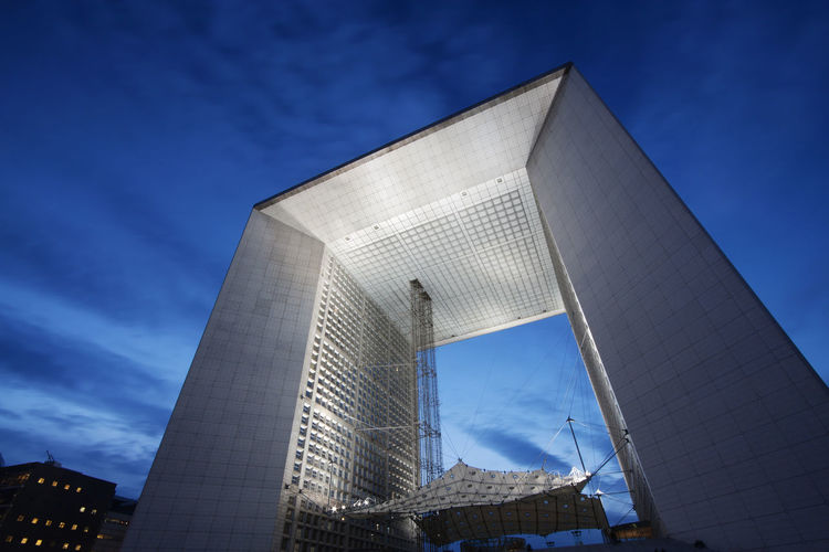 Grand Arche de la Defense in Paris, France, at dusk. Blue Hour France Grand Arche De La Defense La Défense Paris Twilight Building Building Exterior Built Structure Business District City Cloud - Sky Clouds Contemporary Dawn Dusk Dusk In The City Evening Grand Arche Modern Modernity No People Sky Travel Destinations