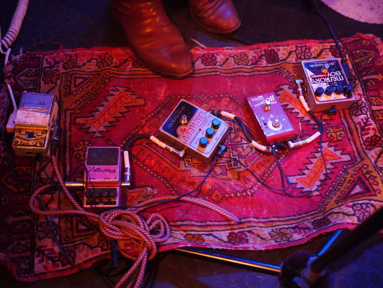 wah-wah pedal at a concert Close-up Communication Concert Photography Day High Angle View Human Body Part Human Hand Indoors  One Person Pedalboard People Table Technology Wah Wah-wah Wahwah Wireless Technology