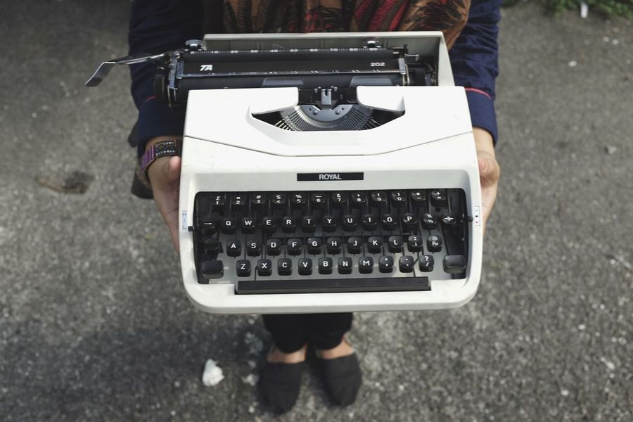 Typist Alphabet Typing Typewriter Women Typist Typewriter Technology One Person Real People High Angle View Low Section Retro Styled EyeEmNewHere Day Midsection Standing Adult Human Body Part Holding Focus On Foreground Lifestyles EyeEmNewHere