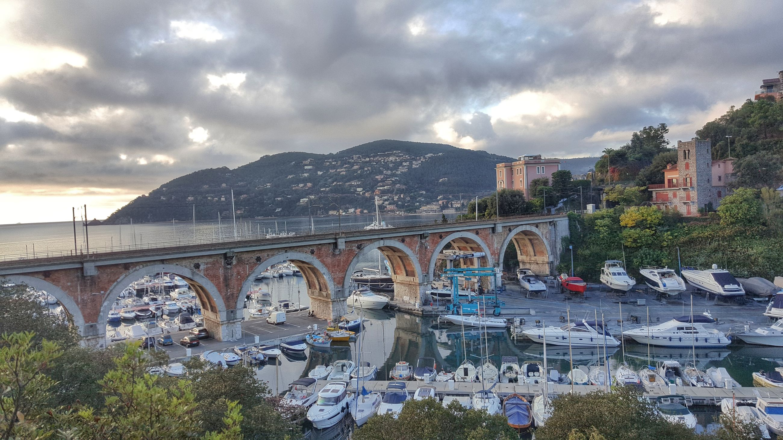 cloud - sky, bridge - man made structure, sky, city, outdoors, architecture, river, travel destinations, no people, flower, cityscape, tree, mountain, nature, day