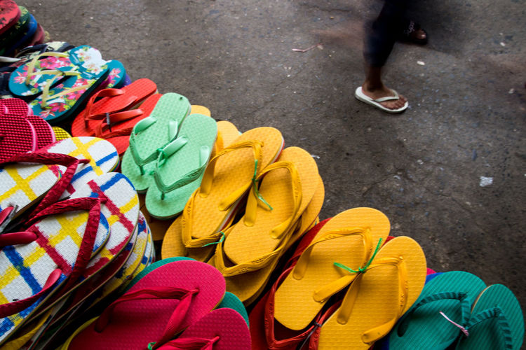 High angle view of flip-flops for sale at market stall