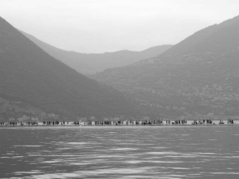 Floating On Water Floating Piers Iseo Lake Italy Brescia 2016 Christo Sulzano Mountain Water Mountain Range Sky Scenics - Nature Waterfront Beauty In Nature Nature Sea Architecture Day Tranquil Scene Tranquility Land Environment Built Structure Building Exterior No People Outdoors