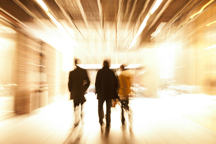 Group of People Walking in Shopping Centre, Motion Blur Adult Blurred Motion Business Businesspeople Center Commuter Concept Horizontal Indoors  Men Motion Office On The Move Only Men People Person Real People Rear View Rushing Shopping The Way Forward Togetherness Tunnel Unrecognizable People Walking