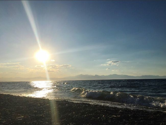 Sea is without roads, sea is without explanation. ❤ Sea Beauty In Nature Water Sunlight Sun Tranquility Nature Scenics Sky No People Sunset Horizon Over Water Wave Beach Tranquil Scene Sunbeam Outdoors Vapor Trail Day Fullness Love Freedom First Eyeem Photo