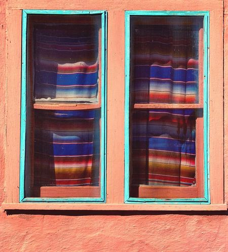 """""""New Mexico True"""" A typical adobe building with double windows and matching drapes truly expresses the culture of New Mexico in the tiny Village of Corona, NM. New Mexico New Mexico Photography Windows Adobe Building Minimalist Architecture Minimalism Minimilism & Simplicity Multi Colored Window No People Built Structure Architecture Building Exterior Pattern Backgrounds Close-up"""
