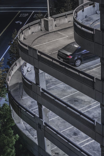 park // Cars Parking Garage Parking Lot Urban Geometry Architecture Black Car Built Structure Car Floors High Angle View Layers Levels No People One One Car Outdoors Parking Solo Tall Transportation Vehicle Vertical