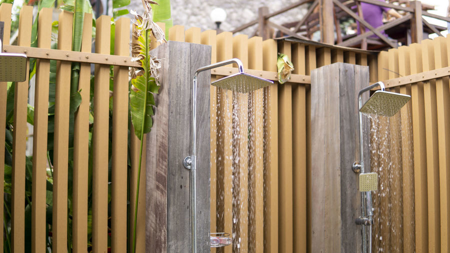 Close-up of bamboo hanging on fence