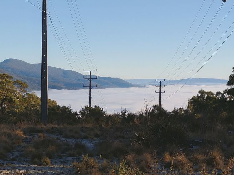 As the suns rises I feel its warmth, I'm higher than the clouds on my morning walk Electricity  Mountain Electricity Pylon Landscape Tree Nature View Abovetheclouds  Morningwalk Sunrise Glow Warmthandsunshine Beauty In Nature Travel Destinations Hobart Tasmania Outdoors Memories Aussielife