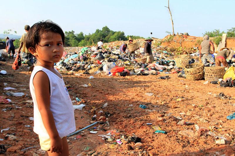 Child in garbage dump ASIA Children Dailylife Dump Garbage INDONESIA People Portraits Proverty The Portraitist - 2017 EyeEm Awards