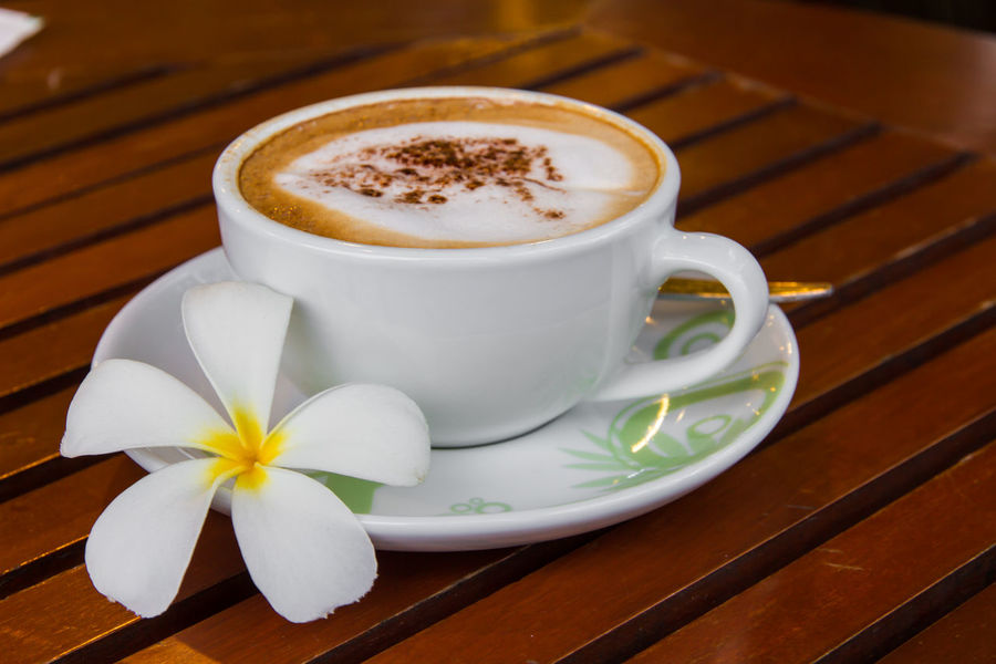 Cappuccino Close-up Coffee - Drink Coffee Cup Day Drink Food And Drink Freshness Frothy Drink Indoors  No People Plumeria Blossoms Plumeria Flowers Refreshment Table