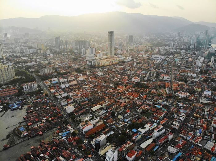 Aerial sunset over georgetown city, penang