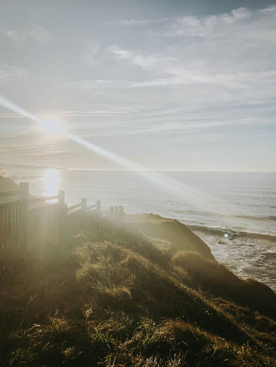 Sky Sea Beauty In Nature Sunlight Land Scenics - Nature Water Nature Environment Sunbeam Landscape Tranquil Scene Cloud - Sky Sun Tranquility Plant Horizon No People Lens Flare Outdoors Bright