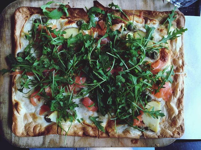 Homemade pizza with arugula