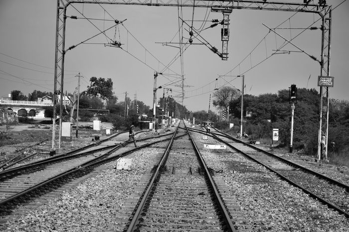 Honour and respect people on different paths of life. For all you know, the paths may become one. B&W Collection Cable Indian Railways Outdoors Paths Of Life Power Line  Rail Tracks Rail Transportation Sky