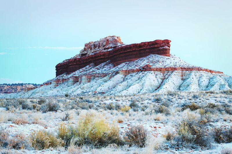 Scenic View Of Snow Covered Rock Formation At Desert During Winter