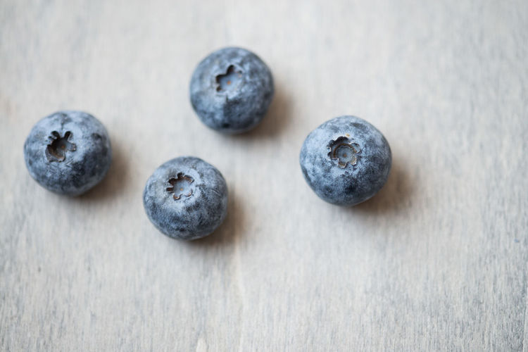 High angle view of blueberries on table