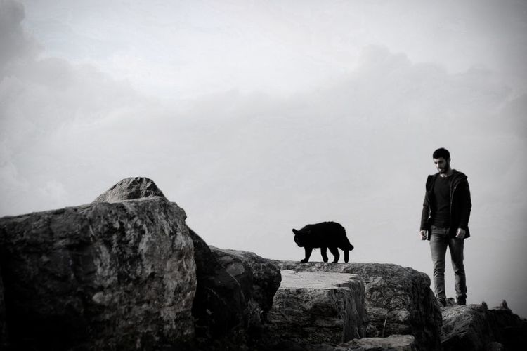 Man standing on rock against mountain