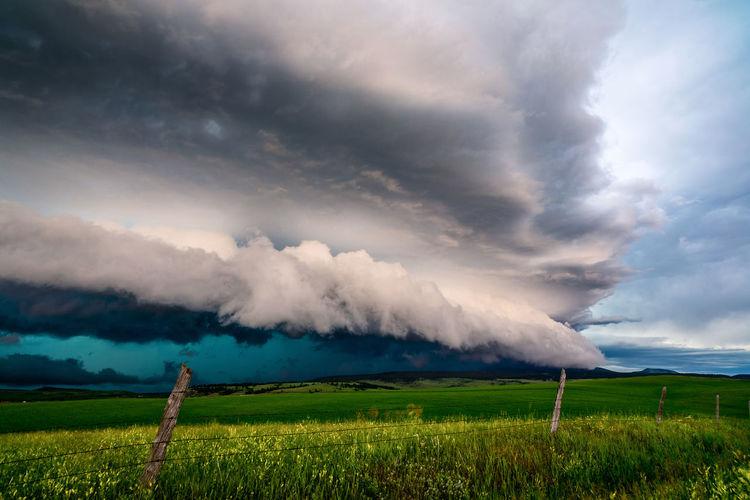 Scenic view of landscape against storm cloud
