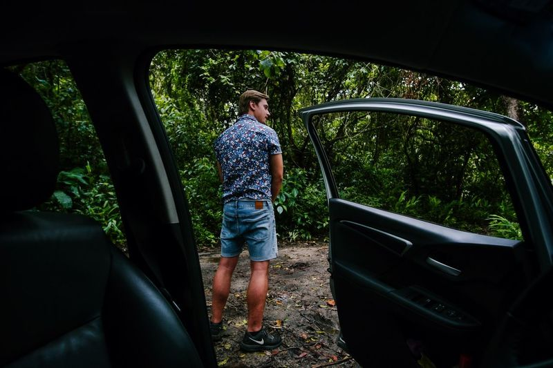 Letting it out Blond Hair Peeing Mode Of Transportation Real People Transportation Car Land Vehicle Motor Vehicle Lifestyles Leisure Activity Casual Clothing Rear View Vehicle Interior One Person Full Length Nature Outdoors Day Travel Tree Plant