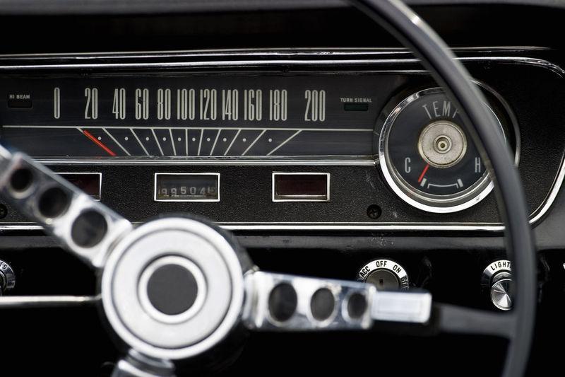 Close-up of steering wheel of vintage car