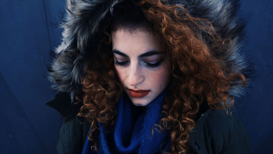Close-Up Of Young Woman In Fur Coat