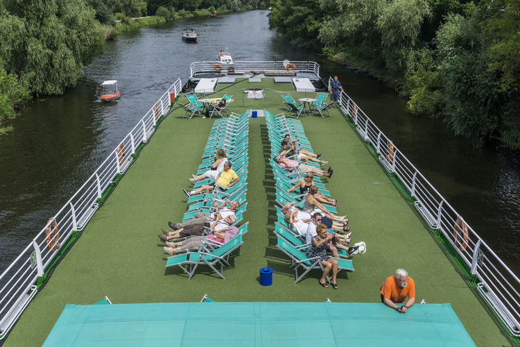 River cruise boat on Havel River Germany 🇩🇪 Deutschland Havel River Horizontal Potsdam Color Image Deck Chairs Outdoors River Cruise Boat Rows