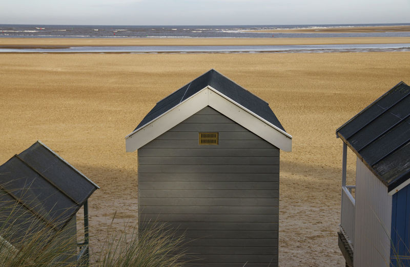Looking out Architecture Land Sea Built Structure Water Beach Nature Building Exterior Horizon Sky Scenics - Nature No People Horizon Over Water Day Hut Building Outdoors Beauty In Nature Sunset Beach Hut Empty Beach Beautiful Beach Looking Out Of The Window Beach Hut View Beach View