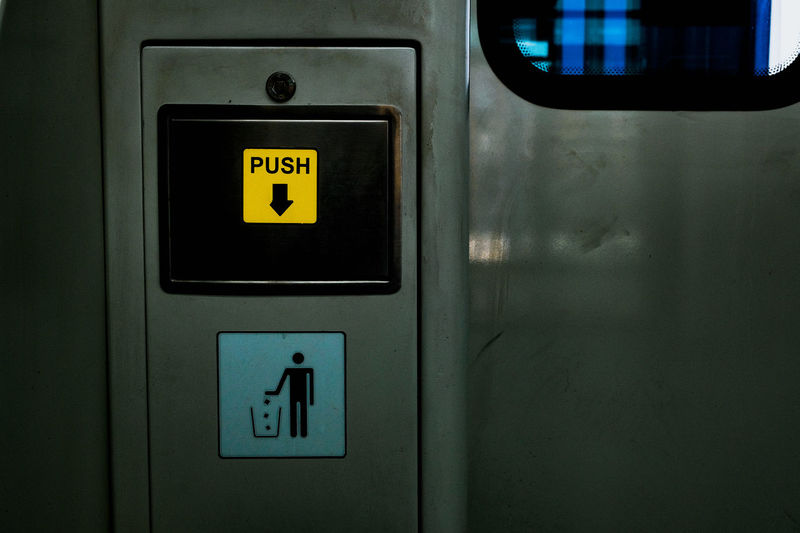 Close-up of push text on door