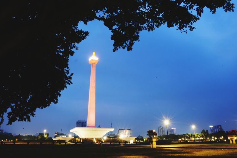 Low angle view of illuminated monument against sky at night