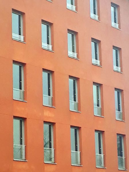 Window Orange Color Red Façade Built Structure Building Exterior Building Height Enjoying Life Colors Tourism EyeEm Selects Modern Geometry Lines Shape Urban Window Building Exterior Architecture Façade Full Frame Built Structure Backgrounds No People Day Cityscape Outdoors City Politics And Government The Graphic City Colour Your Horizn