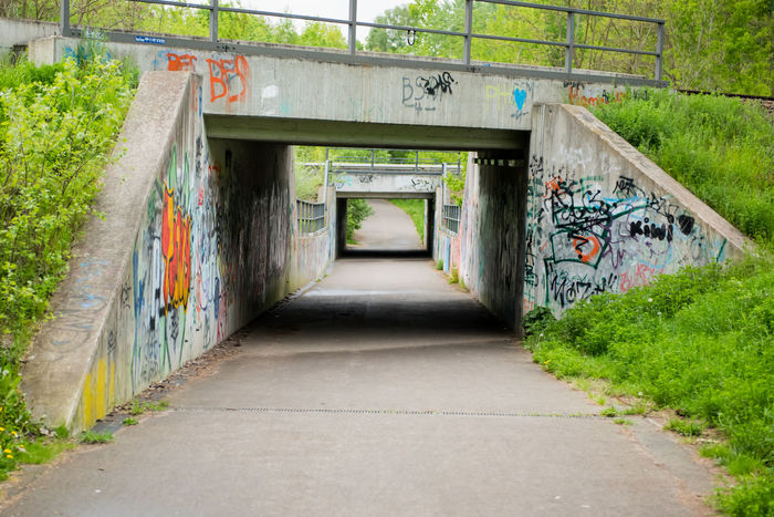 Architecture Bridge Bridge - Man Made Structure Bridges Building Exterior Built Structure Covered Bridge Graffiti Mode Of Transport No People Outdoors Railing The Way Forward Train Bridge Train Bridges Way Forward