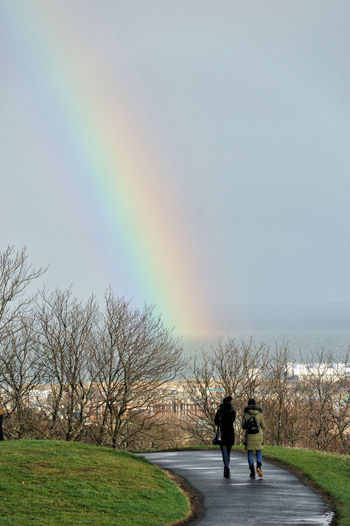 A rainbow seen from Calton Hill, Edinburgh Edinburgh Scotland Rainbow Rainbow Colors Calton Hill City Walking Tree Two People Women Beauty In Nature Outdoors Sky