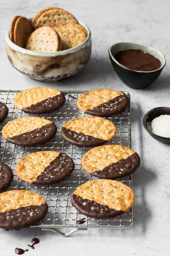 cookies dipped in chocolate   daylight food photography Food Food And Drink Sweet Food Baked Still Life Dessert Sweet No People Ready-to-eat Bowl Close-up Cooling Rack Cookies Chocolate Chocolate Cookies Food Photography Foodphotography Unhealthy Eating Daylight Photography Nikonphotographer