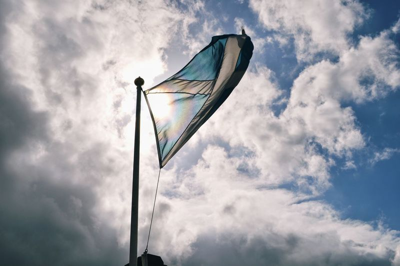 Low angle view of scottish flag against sky