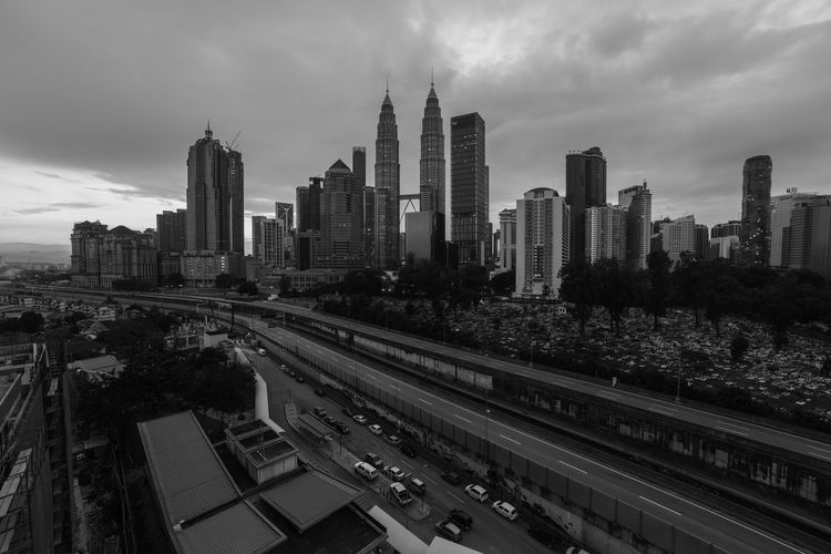 Top view of Kuala Lumper skyline at twilight Architecture Built Structure Building Exterior City Office Building Exterior Skyscraper Sky Building Landscape Urban Skyline Cityscape Tall - High Outdoors Modern Financial District  EyeEm Best Shots EyeEmNewHere Beautiful Attraction Sunrise Metropolitan Skyscrapers Kuala Lumpur Tourism Scenery Destination Scape Towers Highway Petronas Twin Towers Corporate Financial District  Town Shopping Structure Cityscape Park District Dusk Twilight Place Kl Capital Cities  Center Famous Place Tower Travel Downtown View Office